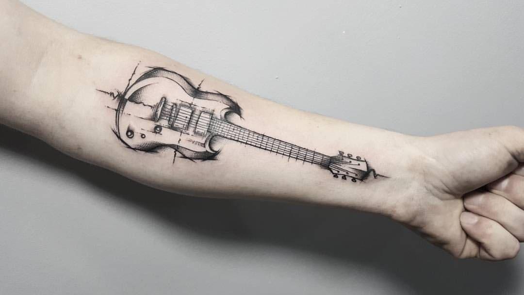 Тату в виде гитары