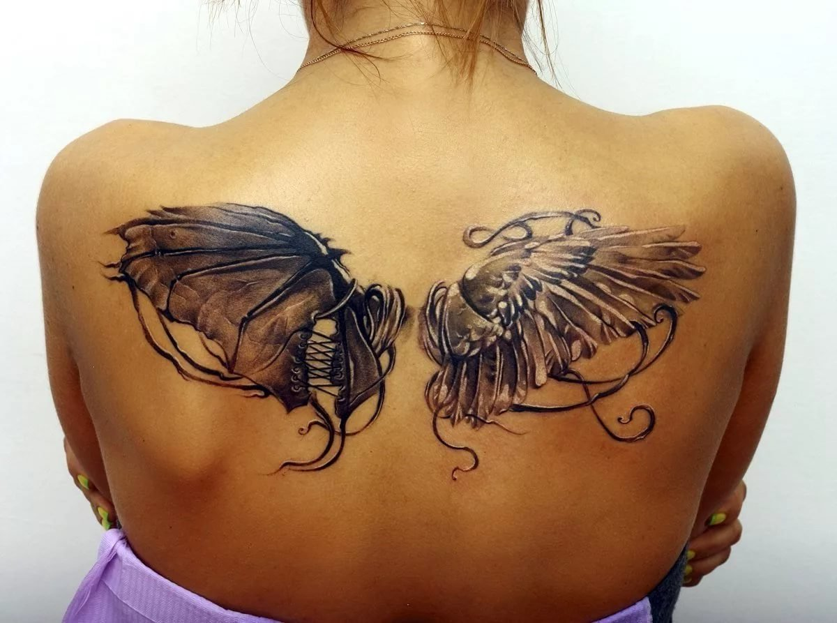 Тату крылья ангела и демона