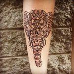 татуировка слон на предплечье